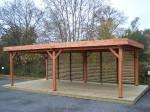 Auvent OMBRA toit plat couverture bac acier + une façade avec ventelles mobiles / 3,54 m x 6,96 m